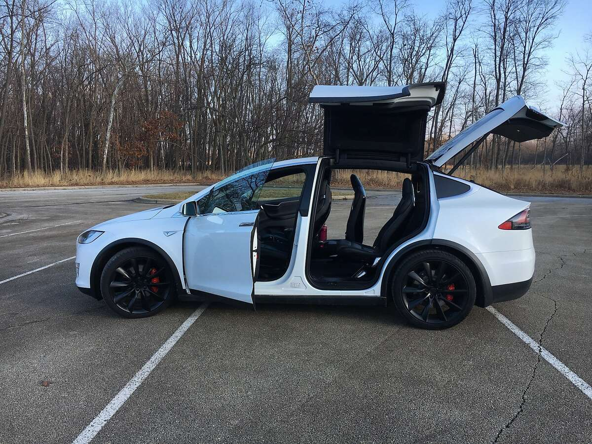 The Tesla Model X P100D all-electric three-row SUV hits 60 mph in 2.9 seconds and uses falcon wing doors to access the rear seats. Tesla settled a lawsuit Wednesday against a former employee's self-driving car startup.