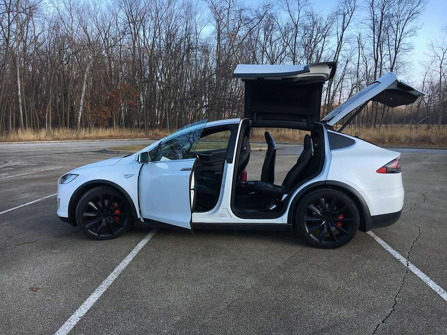 The Tesla Model X P100D all-electric three-row SUV hits 60 mph in 2.9 seconds and uses falcon wing doors to access the rear seats. Tesla settled a lawsuit Wednesday against a former employee's self-driving car startup. Photo: Robert Duffer, TNS