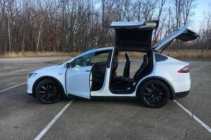 The Tesla Model X P100D all-electric three-row SUV hits 60 mph in 2.9 seconds and uses falcon wing doors to access the rear seats. (Robert Duffer/Chicago Tribune/TNS)