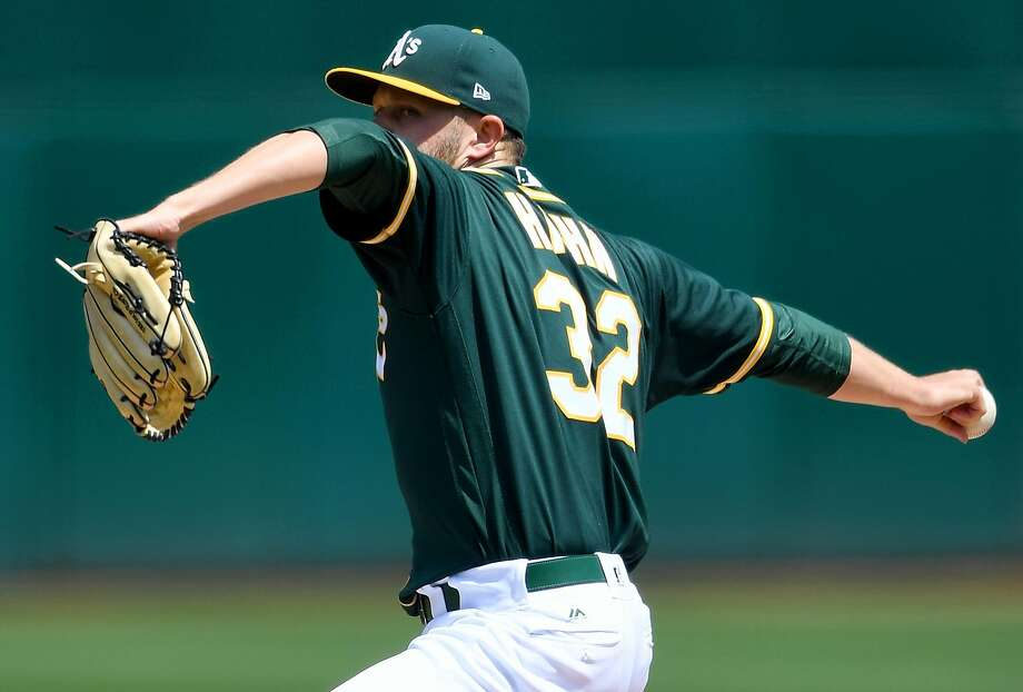 OAKLAND, CA - APRIL 19:  Jesse Hahn #32 of the Oakland Athletics pitches against the Texas Rangers in the top of the first inning at Oakland Alameda Coliseum on April 19, 2017 in Oakland, California.  (Photo by Thearon W. Henderson/Getty Images) Photo: Thearon W. Henderson, Getty Images