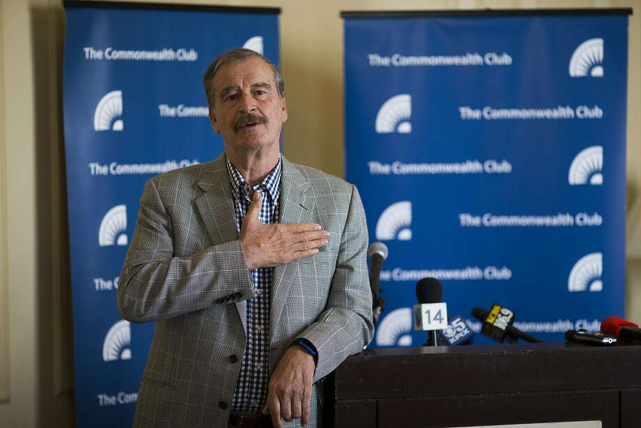 Former Mexican President Vicente Fox answers questions from reporters before speaking to the Commonwealth Club. Photo: Beck Diefenbach, Special To The Chronicle