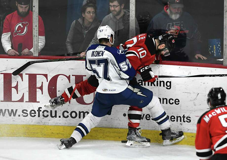 Albany Devils' Rod Pelley and Syracuse Crunch's Henri Ikonen battle for the puck during a hockey game at the Times Union Center Wednesday, April 5, 2017 in Albany, N.Y.(Lori Van Buren / Times Union) Photo: Lori Van Buren / 20039362A