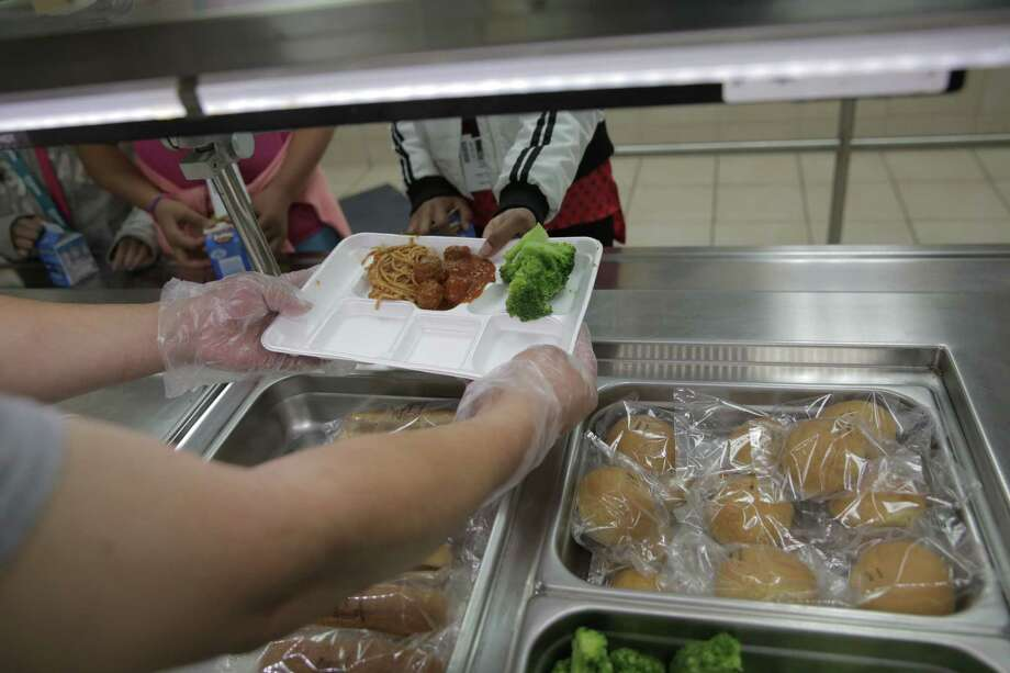 Fourth graders at Hancock Elementary School have their lunch served earlier this month in Houston. The school offers a program where parents can put extra money in the funds so students who forget their lunch money get a full meal. ( Elizabeth Conley / Houston Chronicle ) Photo: Elizabeth Conley, Staff / Stratford Booster Club