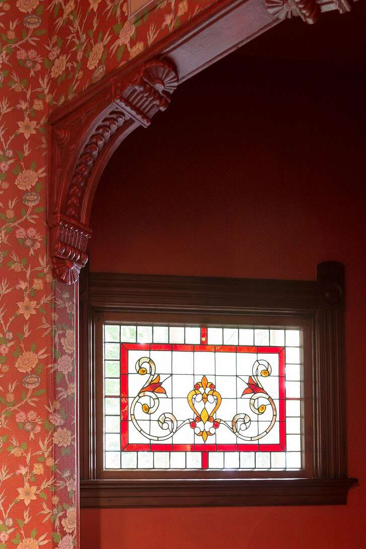 Stained glass and ornate butresses are found throughout the Queen Anne Victorian.