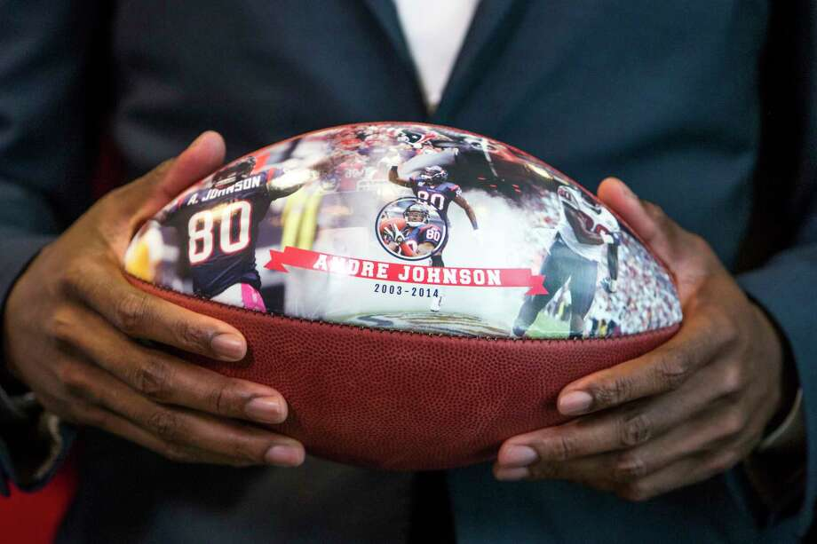 A commemorative football given to Johnson at Wed-nesday's ceremony highlights his sterling career. Photo: Brett Coomer, Staff / © 2017 Houston Chronicle