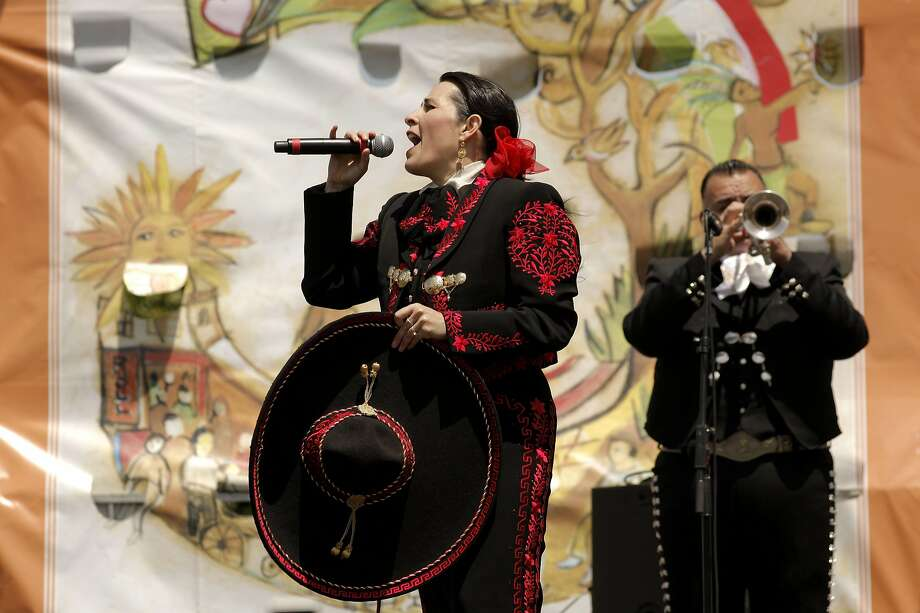 Singer Berta Olivia joins El Mariachi Mexicanisimo at the 2011 Cinco de Mayo festival at Dolores Park in S.F. Photo: Michael Macor, The Chronicle