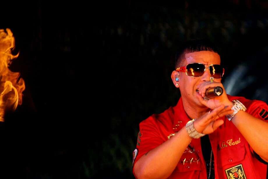 "Puerto Rican reggaeton singer Raymond Ayala, alias Daddy Yankee, performs during his concert at stadium ""Chichi Soza"" of Tegucigalpa, Honduras, Sunday, June 18, 2006. (AP Photo/Edgard Garrido) Photo: EDGARD GARRIDO, AP"