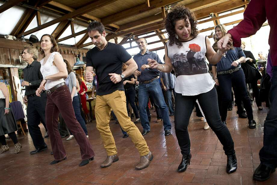 A group practices salsa moves in a class at the Sausalito Seahorse in 2014. Salsa music and dance are inherently tied together. Photo: Laura Morton, Special To The Chronicle