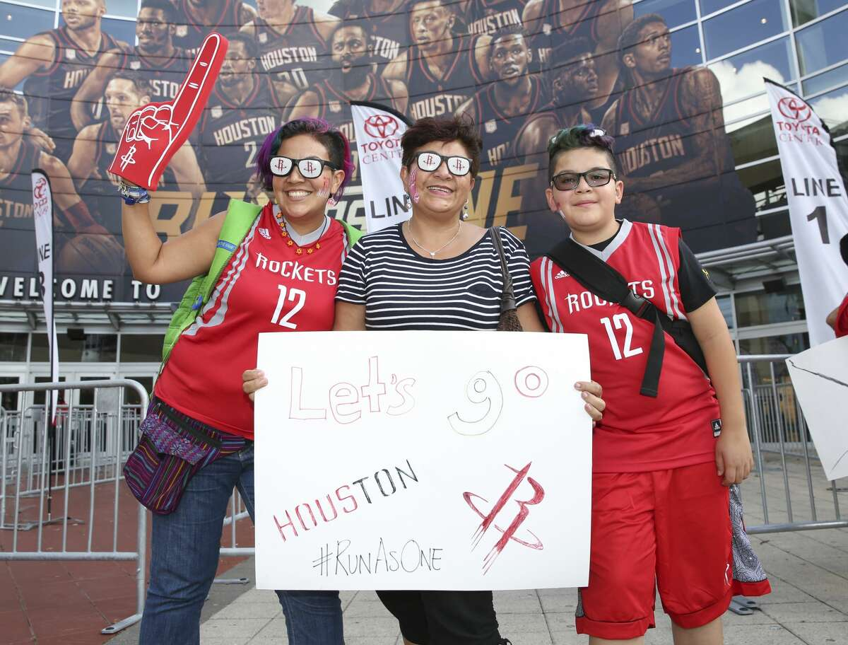 Fans pose for a photo before the Houston Rockets take on the Oklahoma City Thunder in Game 2 of the first-round playoff series at Toyota Center Wednesday, April 19, 2017, in Houston. ( Yi-Chin Lee / Houston Chronicle )