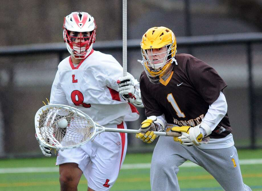 After making a stop, Brunswick goalie Patrick Burkinshaw (1) leads an attack out of his end while being pursued by Lawrenceville's Will Cabrera on Wednesday. Photo: Bob Luckey Jr. / Hearst Connecticut Media / Greenwich Time