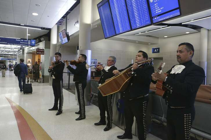 Mariachi Los Galleros de San Antonio performs Wednesday April 19, 2017 at the San Antonio International Airport. Mariachi bands and other forms of entertainment such balloon artist and a caricature artist are visting diffrent areas of the airport during this Fiesta time frame.