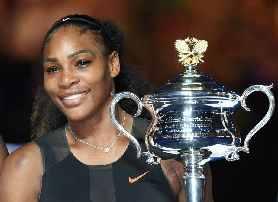 "(FILES) This file photo taken on January 28, 2017 shows  Serena Williams of the US holding the trophy following her victory over Venus Williams of the US in the women's singles final on day 13 of the Australian Open tennis tournament in Melbourne. Serena Williams is indeed pregnant, her publicist confirmed on April 19, 2017, after the tennis great's Snapchat post suggesting she was expecting a baby. ""I'm happy to confirm Serena is expecting a baby this Fall,"" publicist Kelly Bush Novak said in an email to AFP.  / AFP PHOTO / PAUL CROCK / IMAGE RESTRICTED TO EDITORIAL USE - STRICTLY NO COMMERCIAL USEPAUL CROCK/AFP/Getty Images Photo: PAUL CROCK / AFP or licensors"