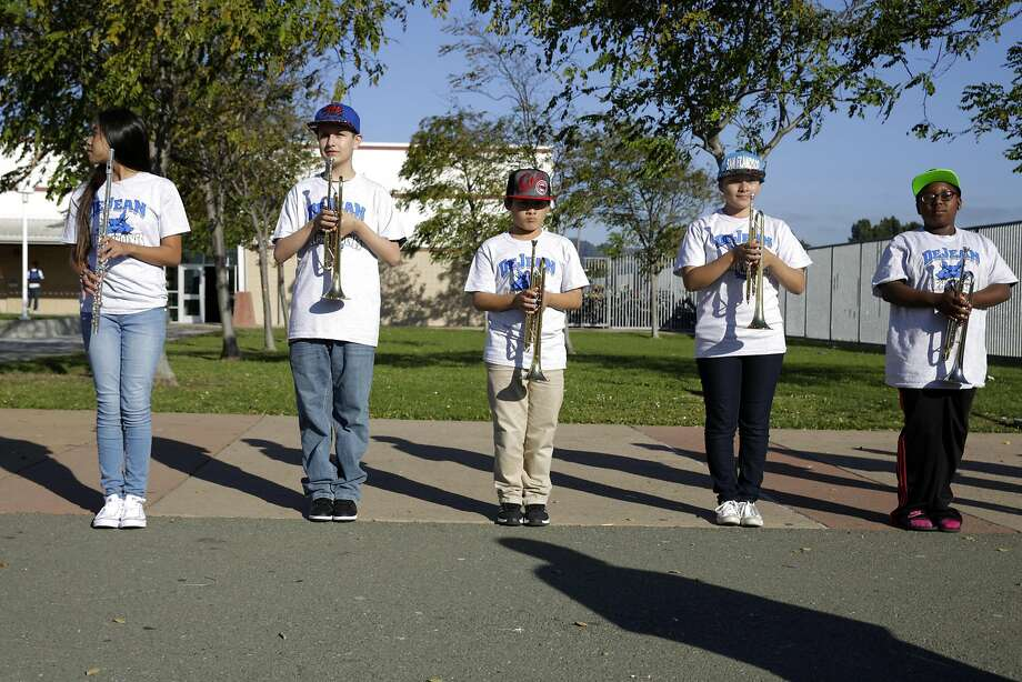 Students from Advanced Band line up as they practice for a performance on back-to-school night. Photo: Lea Suzuki, The Chronicle
