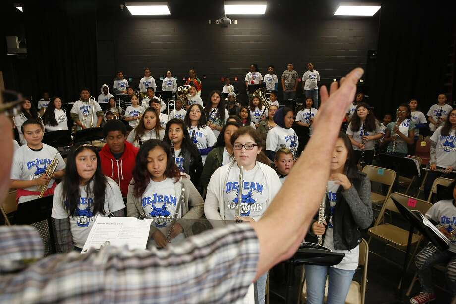 Tim Wilson (partially seen at left), Lovonya DeJean Middle School music director, has the students practice bowing during a rehearsal for the 2016 Fall Concert at Lovonya DeJean Middle School in Richmond. Photo: Lea Suzuki, The Chronicle