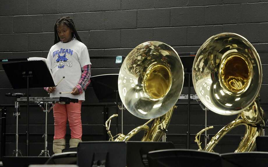 Marcesha Simpson Lenoir, 12, plays the xylophone as students rehearse before the Fall Concert at Lovonya DeJean Middle School in Richmond. Photo: Lea Suzuki, The Chronicle