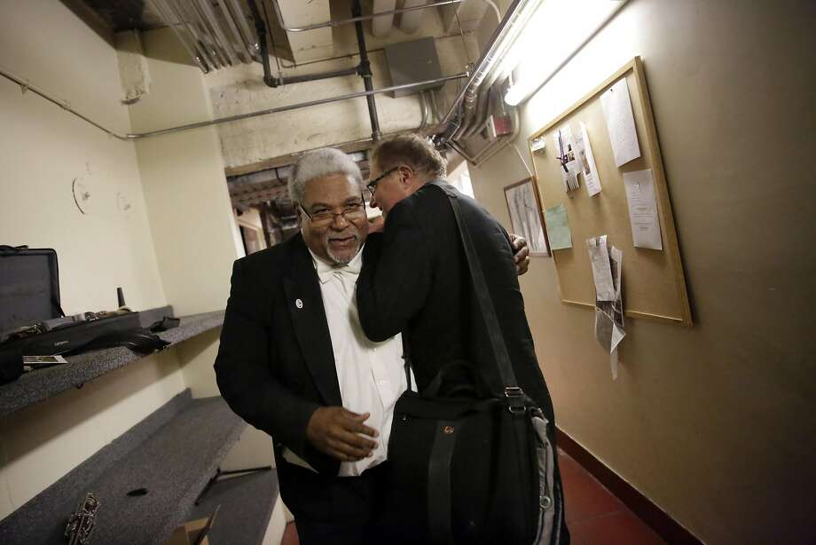 Tim Wilson, music director at Lovonya DeJean Middle School, shares a laugh backstage with friend Rufus Olivier, San Francisco Opera Orchestra principal bassoon, who Wilson used to play with as principal trumpet. Photo: Lea Suzuki, The Chronicle