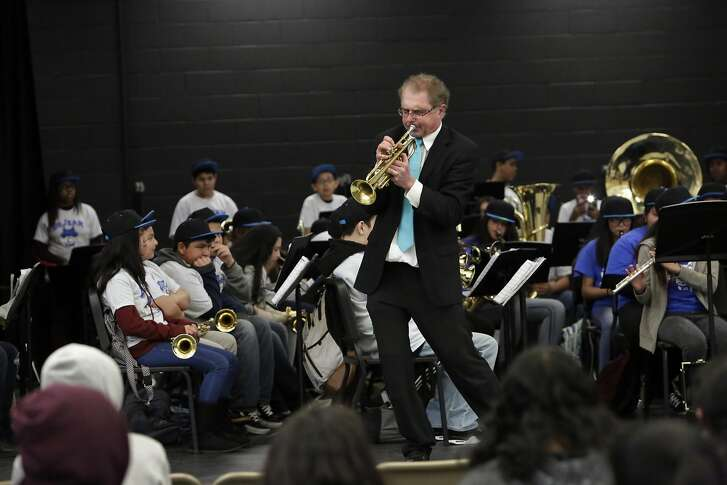 Tim Wilson,��Lovonya DeJean Middle School�music director,�plays the�trumpet�during the Spring Concert as students perform behind him at�Lovonya DeJean Middle School�on Monday, March 20, 2017 in Richmond, Calif.