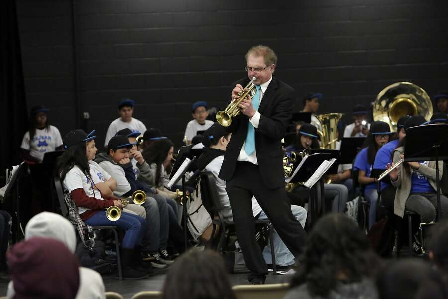 Tim Wilson,Lovonya DeJean Middle Schoolmusic director,plays thetrumpetduring the Spring Concert as students perform behind him atLovonya DeJean Middle Schoolon Monday, March 20, 2017 in Richmond, Calif. Photo: Lea Suzuki, The Chronicle