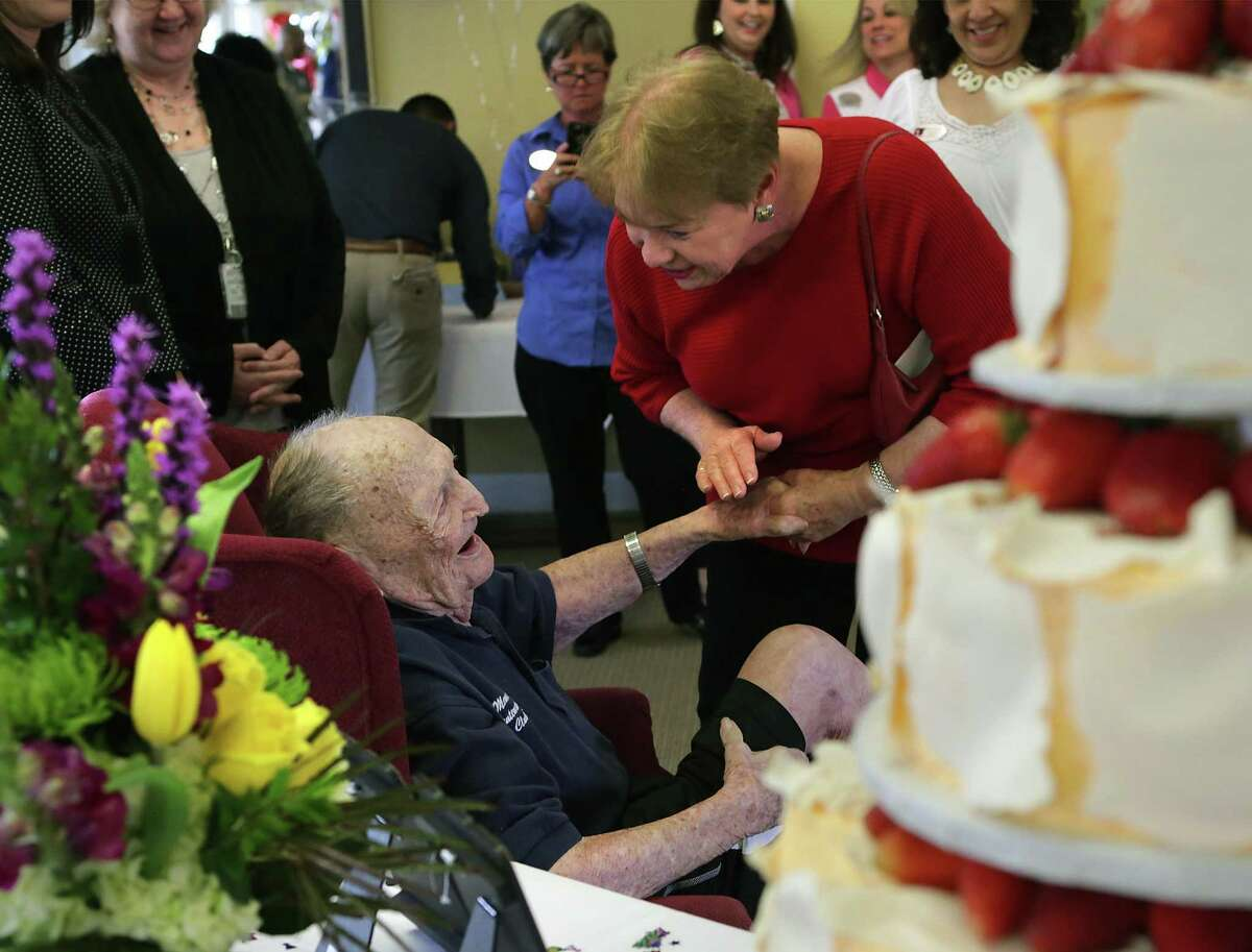 Eugene Ruf, a veteran of World War II, visits with Susan Hinger, right, as he celebrates his 108th birthday on Wednesday, April 19, 2017, at Brookdale Senior Living Solutions with family and friends.