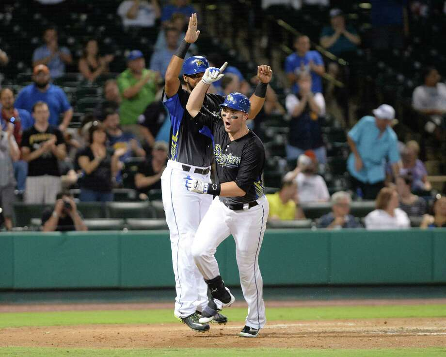 DH Travis Scott, right, of the Skeeters celebrates a two-run homer with Jeremy Barfield in the sixth inning of Game 2 of the Atlantic League championship series against the Long Island Ducks at Constellation Field in September. Photo: Craig Moseley, Staff / ©2016 Houston Chronicle
