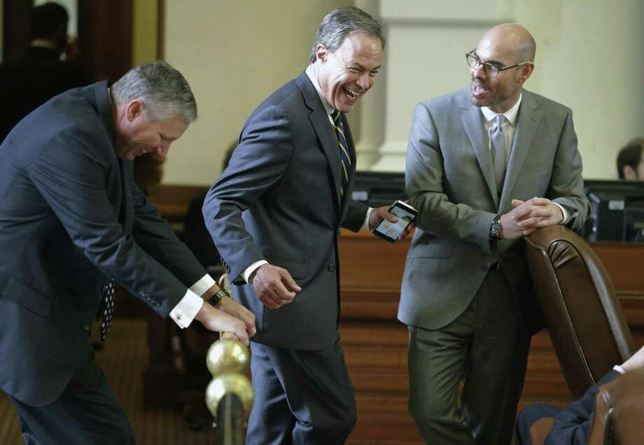 Speaker Joe Straus shares some laughs on the rail with Representative Drew Springer, R-Gainesville (left), and Representative Dennis Bonnen, R-Angleton during the Texas House of Representatives meeting on April 19, 2017. Photo: Tom Reel, Staff / San Antonio Express-News / 2017 SAN ANTONIO EXPRESS-NEWS