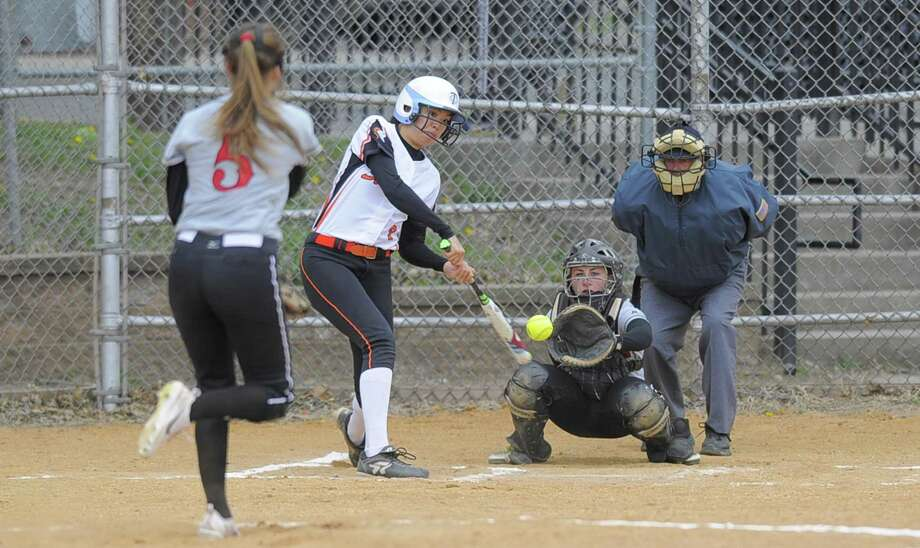 Stamford Sara Staley makes a hit off of New Canaan pitcher Gillian Kane in the second inning of a varsity girls softball game at Stamford High School on April 19, 2017. Stamford defeated New Canaan 4-1. Photo: Matthew Brown / Hearst Connecticut Media / Stamford Advocate
