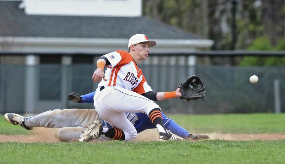 Ridgefield's Colin Motill (20) waits for the throw as Ludlow's Matt Landry (22) slides safely into second for a stolen base in the boys baseball game between Fairfield Ludlow and Ridgefield high schools, on Wednesday, April 19, 2017, in Ridgefield, Conn. Photo: H John Voorhees III / Hearst Connecticut Media / The News-Times