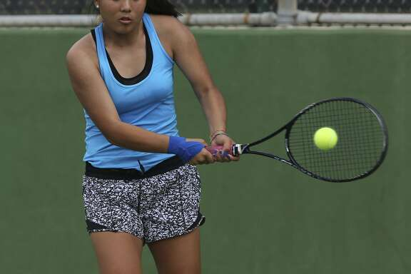 New Braunfels' Sammi Gillas returns a volley April 19, 2017 during the girls singles competition at the Region IV-6A tennis tournament at the McFarlin Tennis Center.