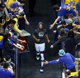 Golden State Warriors' Stephen Curry heads to the court to warm up before playing Portland Trail Blazers in Game 2 of NBA Western Conference 1st Round Playoffs at Oracle Arena in Oakland, Calif., on Wednesday, April 19, 2017.