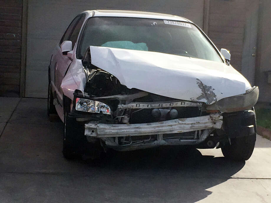 In this Tuesday, April 18, 2017, photo, a 2002 Honda Accord involved in a March 3, 2017, crash in which an exploding Takata air bag inflator badly injured the driver, Karina Dorado, sits in a driveway in Las Vegas. The incident has exposed a danger posed by the recalled parts. Nothing prevents the reuse of air bags from older models to fix wrecked cars that can then be resold, often to unsuspecting buyers. (AP Photo/Ken Ritter) ORG XMIT: NYBZ304 Photo: Ken Ritter / Copyright 2017 The Associated Press. All rights reserved.