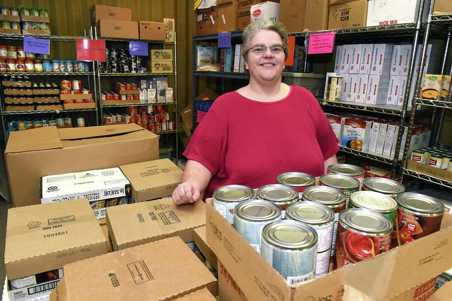 Denise Dunham stands in the Mount Ida Food Pantry on Saturday, April 15, 2017 in Troy, N.Y. Dunham, who runs the pantry, says they're looking for a new location due to the building, the pantry is in now, is being sold. (Lori Van Buren / Times Union) Photo: Lori Van Buren / 20040270A