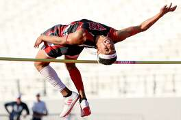 """Wagner's Jamal Anderson clears 6'6"""" in the boys high jump during the District 27/28 6A area high shool track and field meet at Rutledge Stadium on Wednesday, April 19, 2017.  Anderson also jumped 48' 8 3/4"""" in the triple jump on his first jump to take first place in that event.  MARVIN PFEIFFER/ mpfeiffer@express-news.net"""