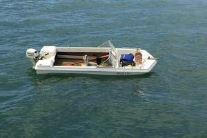 Authorities were searching Wednesday for a missing man from Oakland whose ten-foot skiff capsized off Muir Beach in Marin County.
