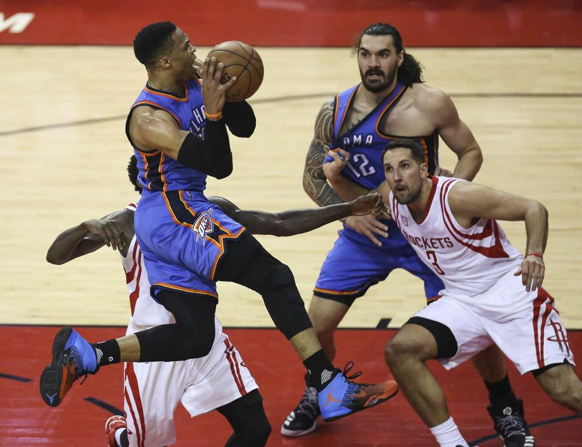 Oklahoma City Thunder guard Russell Westbrook (0) goes for the basket as the Houston Rockets take on the Oklahoma City Thunder during the first quarter in Game 2 of the first-round playoff series at Toyota Center Wednesday, April 19, 2017, in Houston. ( Yi-Chin Lee / Houston Chronicle )