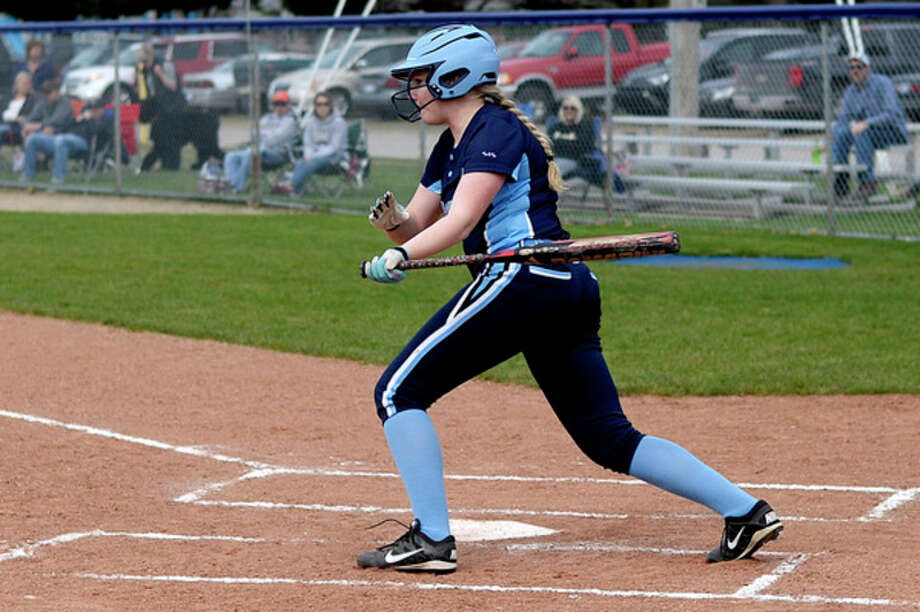 NICK KING   nking@mdn.net Meridian's MaKayla Kent drives in a run against Bullock Creek during the first inning on Wednesday at Meridian High School. / Midland Daily News