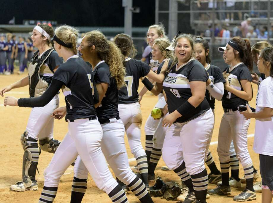 The Foster Falcons celebrate after defeating the Angleton Wildcats 6-5 in a girls High School Softball game on Wednesday, April 19, 2017 at Foster High School in Richmond, Texas. Photo: Wilf Thorne/For The Chronicle