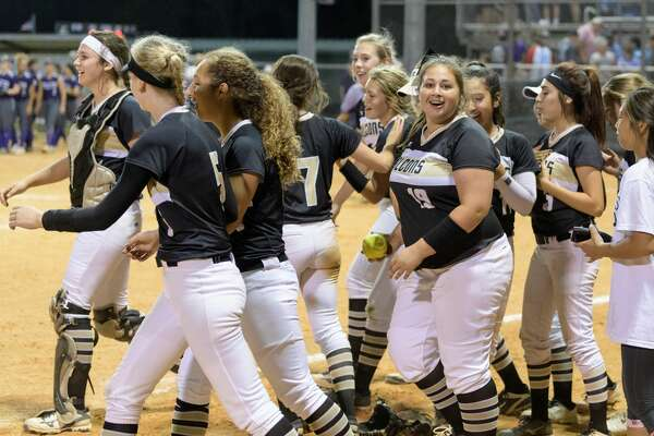 The Foster Falcons celebrate after defeating the Angleton Wildcats 6-5 in a girls High School Softball game on Wednesday, April 19, 2017 at Foster High School in Richmond, Texas.