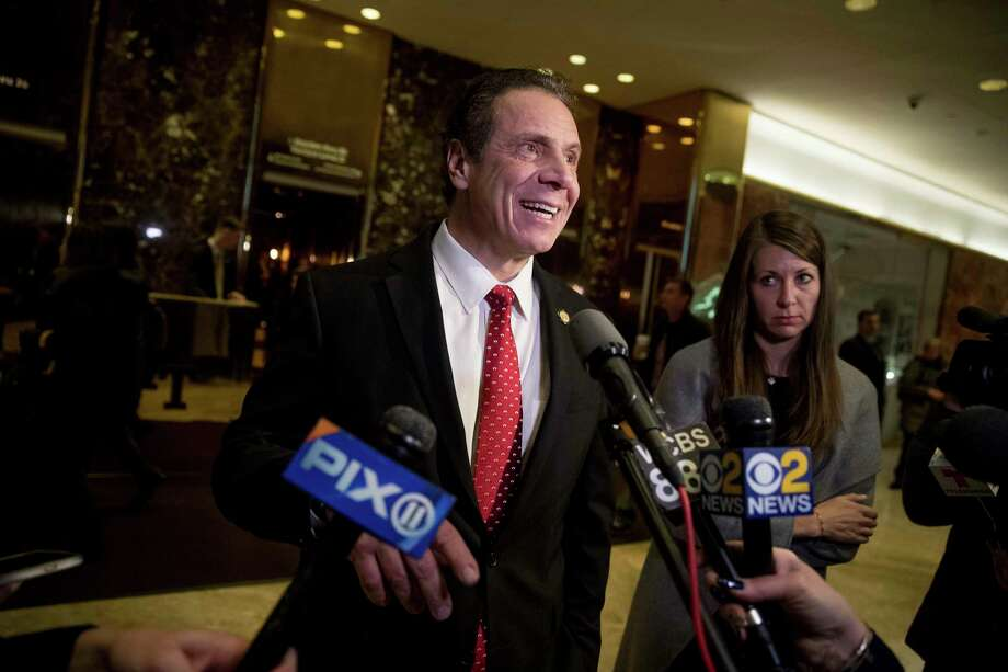New York Gov. Andrew Cuomo, center, accompanied by his chief of staff Melissa DeRosa, right, speaks to members of the media after meeting with President-elect Donald Trump at Trump Tower in New York, Wednesday, Jan. 18, 2017. (AP Photo/Andrew Harnik) ORG XMIT: NYAH109 Photo: Andrew Harnik / Copyright 2017 The Associated Press. All rights reserved.