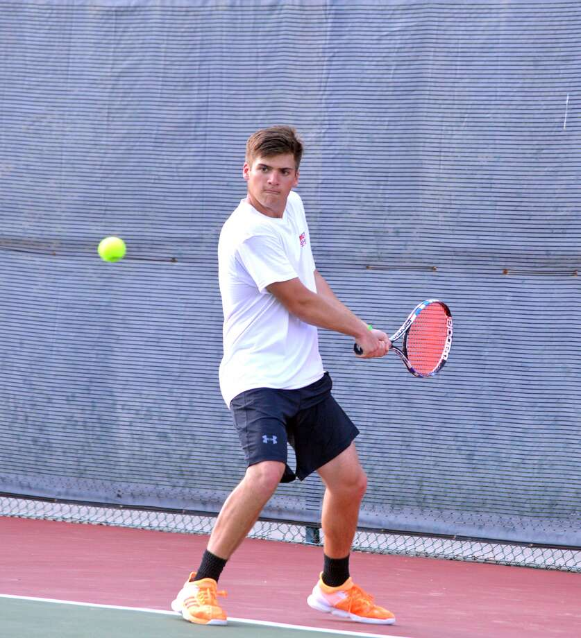 Edwardsville sophomore Seth Lipe prepares to hit a backhand during Wednesday's Southwestern Conference match at Collinsville