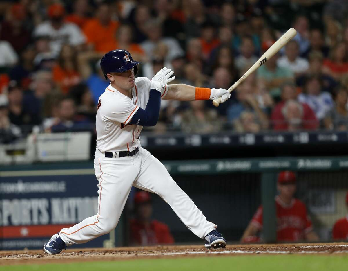 Houston Astros shortstop Alex Bregman (2) hits a double during the fifth inning of an MLB baseball game at Minute Maid Park, Wednesday, April 19, 2017, in Houston. ( Karen Warren / Houston Chronicle )