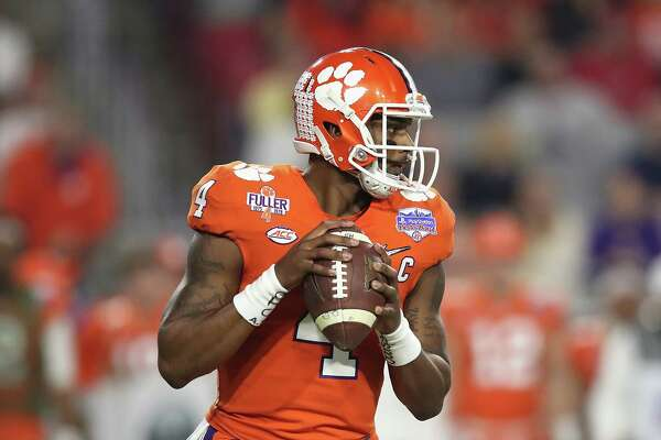 GLENDALE, AZ - DECEMBER 31:  Deshaun Watson #4 of the Clemson Tigers looks to pass the ball against the Ohio State Buckeyes during the 2016 PlayStation Fiesta Bowl at University of Phoenix Stadium on December 31, 2016 in Glendale, Arizona.  (Photo by Matthew Stockman/Getty Images)
