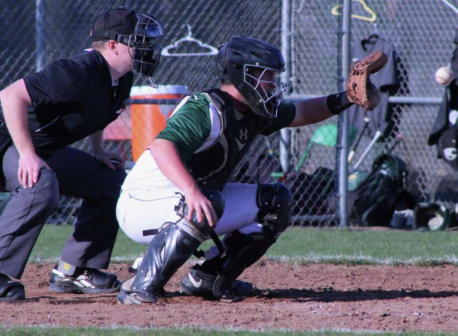 Tis the season for baseball. The New Milford High School varsity baseball team recently played Bethel. The Green Wave took home a win, 6-5. Above, NMHS junior Derek Profita makes a fine catch during the game. Photo: Courtesy Of Katie Alzapiedi / The News-Times Contributed