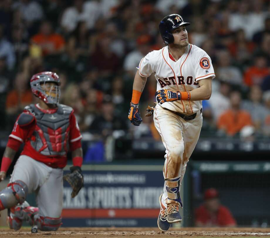 Houston Astros Josh Reddick (22) watches his ball just go over the wall as he hit a home run during the seventh inning of an MLB baseball game at Minute Maid Park, Wednesday, April 19, 2017, in Houston. ( Karen Warren / Houston Chronicle ) Photo: Karen Warren/Houston Chronicle