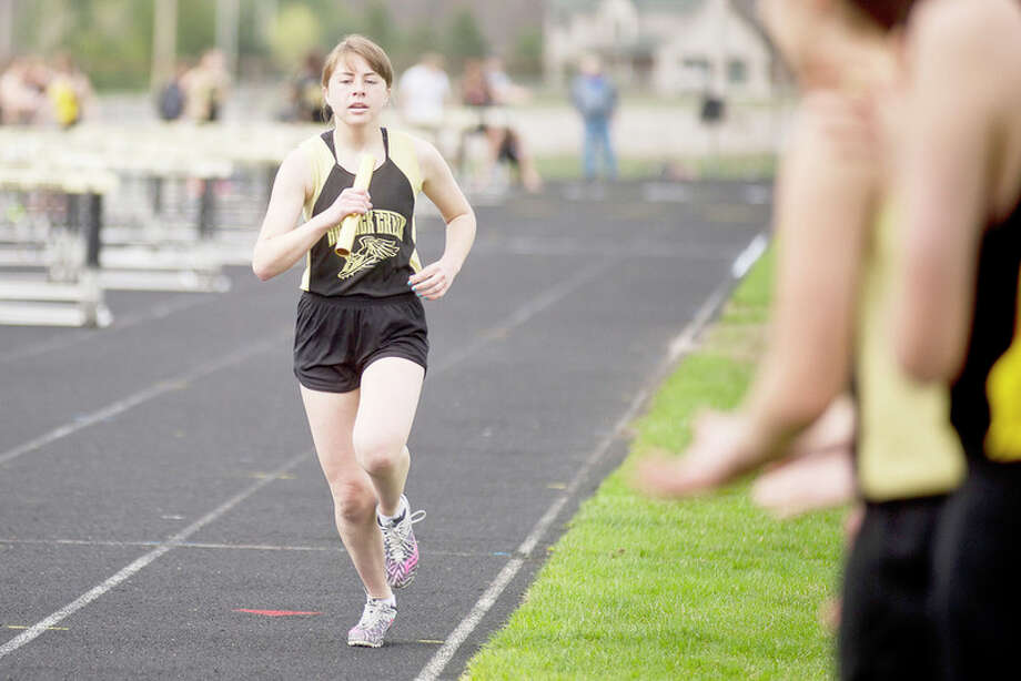 ERIN KIRKLAND | ekirkland@mdn.net Bullock Creek's Bailie Gagne competes in the 3,200-meter relay in Wednesday's meet against Chesaning and Swan Valley. / Midland Daily News