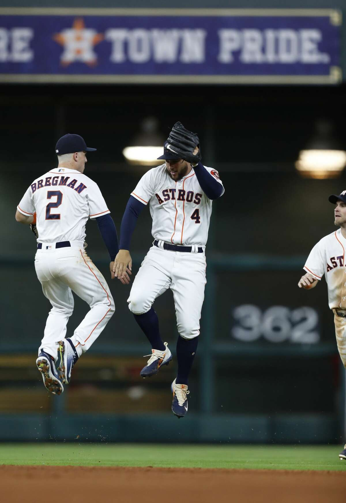 Houston Astros shortstop Alex Bregman (2) and George Springer (4) celebrate the Astros 5-1 win after an MLB baseball game at Minute Maid Park, Wednesday, April 19, 2017, in Houston. ( Karen Warren / Houston Chronicle )