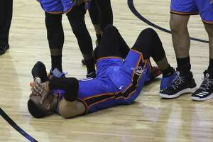 Oklahoma City Thunder guard Russell Westbrook (0) covers his face on the floor as he was fouled by Houston Rockets guard Eric Gordon (10) as the Houston Rockets take on the Oklahoma City Thunder during the fourth quarter in Game 2 of the first-round playoff series at Toyota Center Wednesday, April 19, 2017, in Houston. The Rockets defeated the Thunders 115-111. ( Yi-Chin Lee / Houston Chronicle )