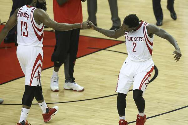 Houston Rockets players James Harden (13) and Patrick Beverley (2) do a celebration dance as the Houston Rockets take on the Oklahoma City Thunder during the fourth quarter in Game 2 of the first-round playoff series at Toyota Center Wednesday, April 19, 2017, in Houston. The Rockets defeated the Thunders 115-111. ( Yi-Chin Lee / Houston Chronicle )
