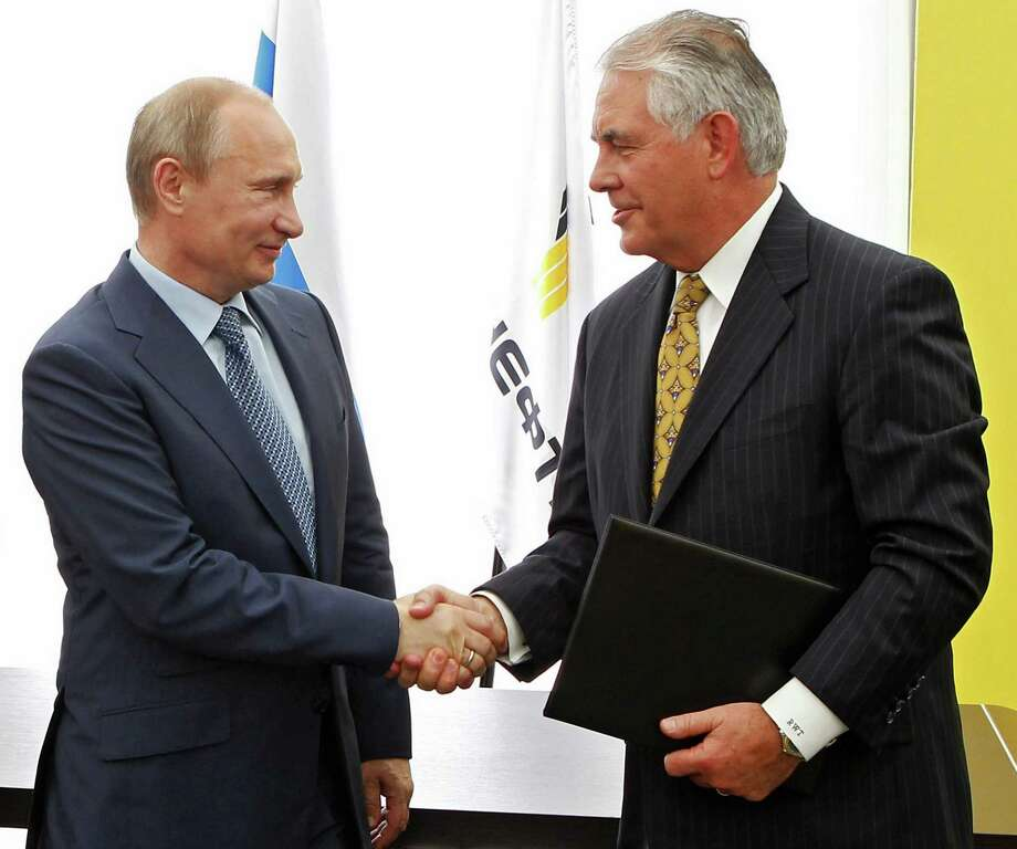 Russian President Vladimir Putin and Rex Tillerson, then Exxon Mobil's CEO, at a ceremony in 2012.  Photo: Mikhail Klimentyev, POOL / AP2012