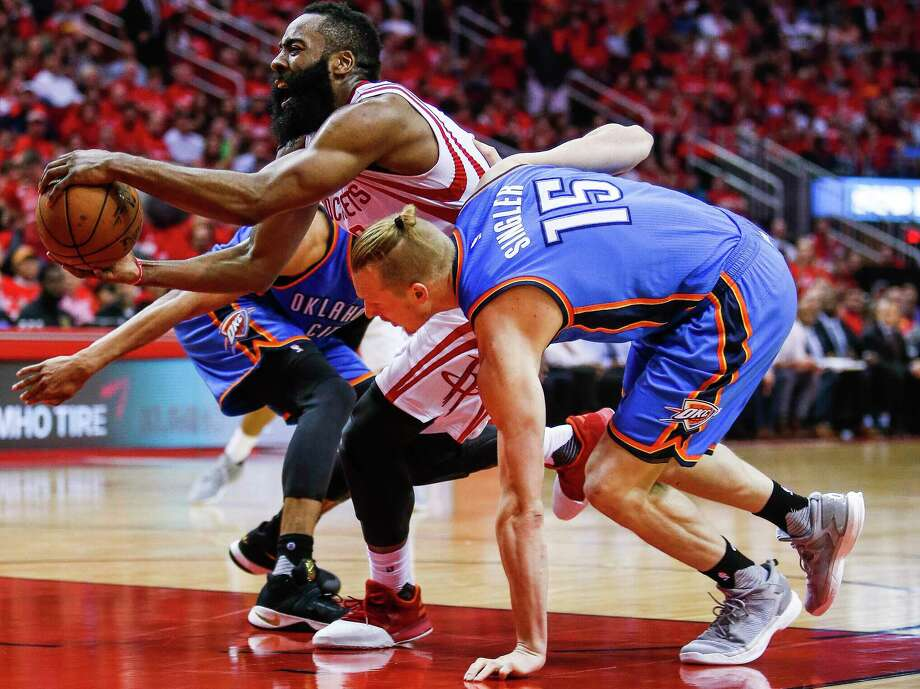Houston Rockets guard Eric Gordon (10) takes a shot as Oklahoma City Thunder center Steven Adams (12) flies past as the Houston Rockets take on the Oklahoma City Thunder in Game 2 of the first-round playoff series Wednesday, April 19, 2017 in Houston at the Toyota Center. ( Michael Ciaglo / Houston Chronicle) Houston Rockets guard James Harden (13) reacts as he is fouled while being defended by Oklahoma City Thunder forward Kyle Singler (15) as the Houston Rockets take on the Oklahoma City Thunder in Game 2 of the first-round playoff series Wednesday, April 19, 2017 in Houston at the Toyota Center. ( Michael Ciaglo / Houston Chronicle) Photo: Michael Ciaglo, Staff / Michael Ciaglo