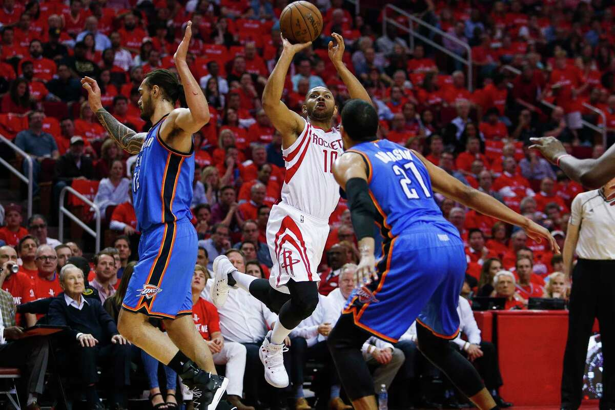 Houston Rockets guard Eric Gordon (10) takes a shot as Oklahoma City Thunder center Steven Adams (12) flies past as the Houston Rockets take on the Oklahoma City Thunder in Game 2 of the first-round playoff series Wednesday, April 19, 2017 in Houston at the Toyota Center. ( Michael Ciaglo / Houston Chronicle)